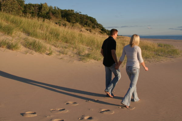 walking on beach holding hands
